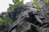 A soldier climbs a cliff face at Camp Ethan Allen Training Site in Jericho, Vt., Aug. 21, 2016. Army National Guard photo by Spc. Avery Cunningham
