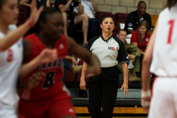 U.S. Referee Lolly Saenz officiates the China vs. Canada game at the Conseil International Du Sport Militaire (CISM) World Military Women's Basketball Championship July 28 at Camp Pendleton, California. The base is hosting the CISM World Military Women's Basketball Championship July 25 through July 29 to promote peace activities and solidarity among military athletes through sports.  The United States is hosting teams from Brazil, Canada, China, France, and Germany.  (U.S. Marine Corps photo by Sgt. Abbey Perria)