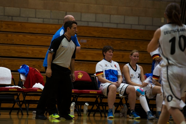 Brazil Army Sgt. Adriano Almeida referees the Germany vs. United States game during the Conseil International Du Sport Militaire (CISM) World Military Women's Basketball tournament  July 28 at Camp Pendleton, California. The base is hosting the CISM World Military Women's Basketball Championship July 25 through July 29 to promote peace activities and solidarity among military athletes through sports.  The United States is hosting teams from Brazil, Canada, China, France, and Germany.   (U.S. Marine Corps photo by Sgt. Abbey Perria)