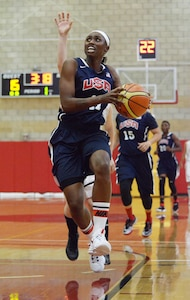 Creshenda Singletary breaks downcourt to score two points for Team USA against Germany during CISM women's basketball at Camp Pendleton, July 28, 2016. Singletary of Fort Bragg, N.C., was the game's leading scorer with 16 points as USA beat Germany 93-37.
