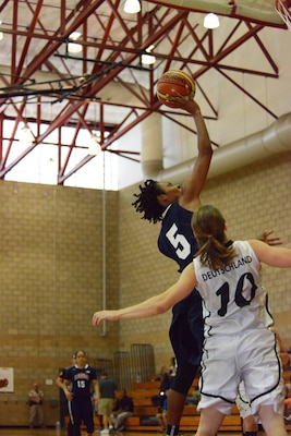 Sr. Airman Jessica St. Cyr of Robbins Air Force Base, Ga., makes a layup over defending German Sgt. Nancy Loth during USA's win over Germany, July 28, 2016, in the CISM Women's Basketball Championship at Camp Pendleton, Calif.