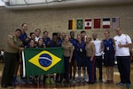 Team Brazil poses for a group picture after winning the final game at the Conseil International Du Sport Militaire (CISM) World Military Women's Basketball Championship July 29 at Camp Pendleton, California.  The tournament ended July 29, with Brazil winning the last game in the final seconds.  U.S.A took second place, and China will return home with the Bronze. The base hosted the CISM World Military Women's Basketball Championship July 25 through July 29 to promote peace activities and solidarity among military athletes through sports.  Teams from Canada, France, and Germany also participated (U.S. Marine Corps photo by Sgt. Abbey Perria)