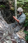 A soldier rappels down a cliff face at Camp Ethan Allen Training Site in Jericho, Vt., Aug. 21, 2016. Army National Guard photo by Spc. Avery Cunningham