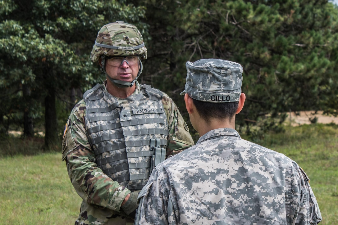 FORT MCCOY, Wis. – In August 2016, U.S. Army Reserve Brig. Gen. Vincent Barker, Commanding General of the 310th Expeditionary Sustainment Command, is interviewed by U.S. Army Reserve 1st Lt. Angelina Cillo of the 366th Mobile Public Affairs Detachment from Wichita, Kan. Exercise News Day is tasked to provide public affairs support during annual training, like combat support training exercise, throughout the U.S. Army Reserve.  (U.S. Army Reserve Photo by Sgt. Clinton Massey, 206th Broadcast Operations Detachment/Released)