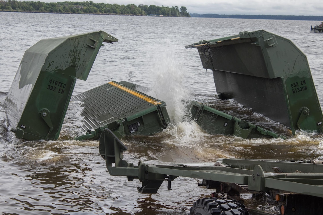 FORT MCCOY, Wis. - A large section of a floating bridge opens as it settles into Petenwell Lake, Wis., in August 2016. The U.S. Army Reserve engineers, of the 652d Multi-Role Bridge Company from Hammond, Wis., use multiple bridge pieces to make a raft for transporting vehicles and Soldiers across bodies of water. The combat support training exercise allows U.S. Army Reserve units, like the 652d, to practice their skills in a real environment. (U.S. Army Reserve Photo by Sgt. Clinton Massey, 206th Broadcast Operations Detachment/Released)