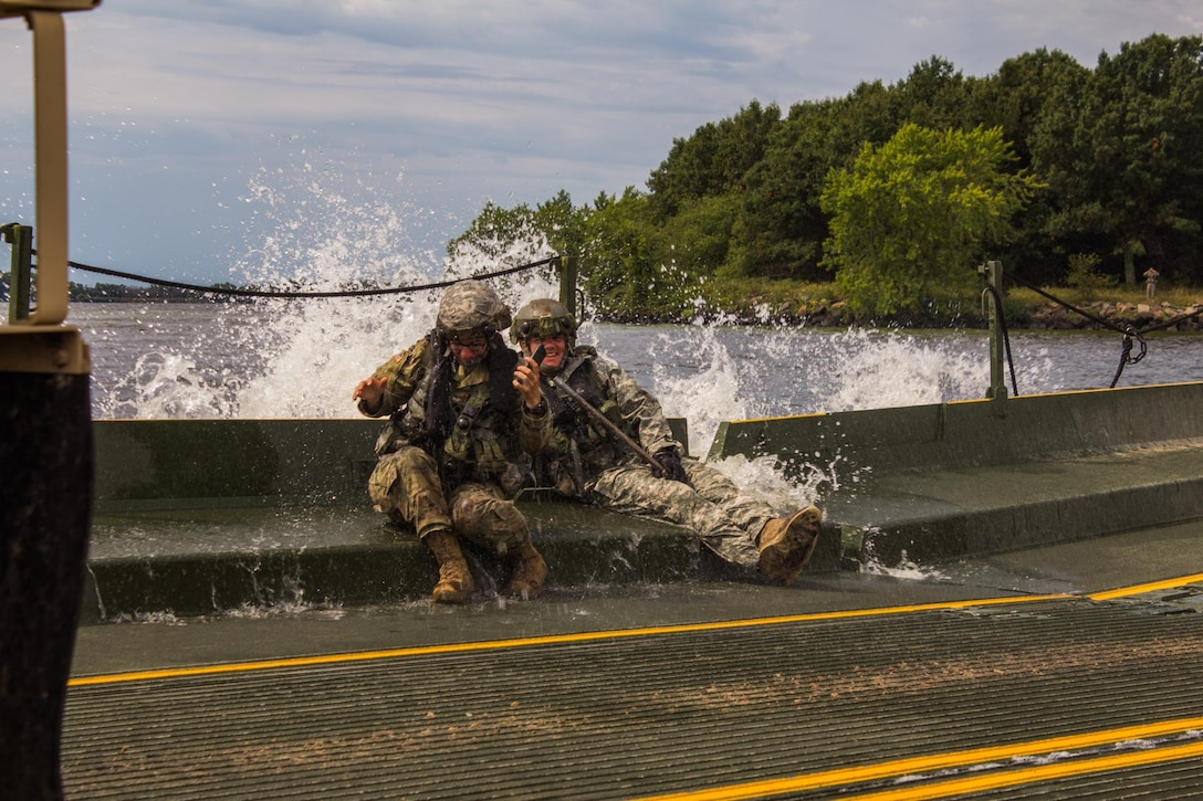 FORT MCCOY, Wis. – U.S. Army Reserve Soldiers with the 652d Multi-Role Bridge Company of Hammond, Wis. have a splash in August 2016. The 652d assembles a raft on Petenwell Lake, Wis. and maneuvers vehicles and Soldiers across large bodies of water as part of the combat support training exercise. The CSTX held at Fort McCoy, allows U.S. Army Reserve units, like the 652d, to practice their skills in a real environment. (U.S. Army Reserve Photo by Sgt. Clinton Massey, 206th Broadcast Operations Detachment/Released)