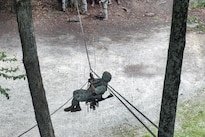 Army Spc. Peter Burtt descends a highline rope system at Camp Ethan Allen Training Site in Jericho, Vt., Aug. 21, 2016. Burtt is assigned to the Vermont National Guard's Company A, 3rd Battalion, 172nd Infantry Regiment (Mountain). Army National Guard photo by Spc. Avery Cunningham
