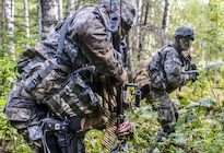 Soldiers react to contact during exercise Spartan Agoge at Joint Base Elmendorf-Richardson, Alaska, Aug. 18, 2016. The battalion trained in close combat, reconnaissance, chemical warfare and infiltration skills. The soldiers are assigned to Company C, 1st Battalion, 501st Parachute Infantry Regiment, 4th Infantry Brigade Combat Team (Airborne). Army photo by Staff Sgt. Daniel Love