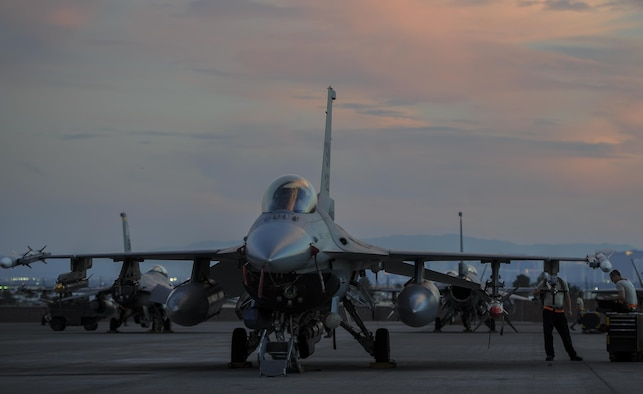 An F-16CJ, assigned to the 79th Fighter Squadron, Shaw Air Force Base, S.C., sits on the flightline during Red Flag 16-3 before take-off at Nellis Air Force Base, Nevada, July 25, 2016. Airmen from the National Air and Space Intelligence Center Operational Requirements Squadron's Weapons and Tactics Team integrated non-kinetic effects into the exercise, providing pilots the ability to train against cyber threats. (U.S. Air Force photo by Airman 1st Class Kevin Tanenbaum/Released)