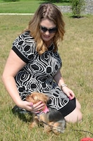 """JoAnn Anderson, the acting department head of the public affairs department at the Defense Information School on Fort Meade, holds her adopted Yorkie, Bella, outside the school Aug. 16, 2016.  To Anderson, who already had cats, Bella was different. """"I feel like her mamma,"""" she said."""