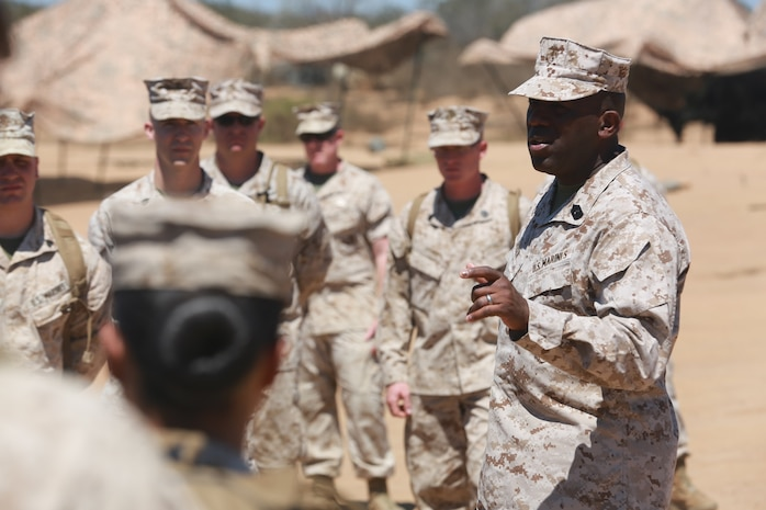 The 18th Sergeant Major of the Marine Corps, Ronald L. Green, speaks with Marines of Combat Logistics Battalion 15, Headquarters Regiment, 1st Marine Logistics Group, during a Tactical Convoy Course on Camp Pendleton Calif., Aug. 16, 2016. Sergeant Major Green discussed issues with in the Marine Corps and protecting that you earn. (Official U.S. Marine Corps photo by Sgt. Rodion Zabolotniy)