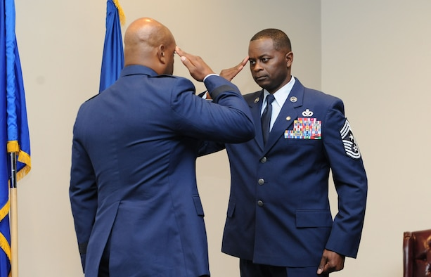 Chief Master Sgt. Harry Hutchinson, 81st Training Wing command chief, salutes Brig. Gen. Trent Edwards, Headquarters Air Force Space Command financial management and comptroller director, Peterson Air Force Base, Colo., during his retirement ceremony at the Roberts Consolidated Aircraft Maintenance Facility Aug. 19, 2016, on Keesler AFB, Miss. Hutchinson retired with more than 29 years of military service and served multiple assignments in Washington state, Korea, Maryland, Japan, Nevada, South Dakota and Africa. He also worked as the superintendent of the U.S. Army's RED HORSE sites in Iraq and Afghanistan and the Air Force's 732nd Expeditionary Prime BEEF squadron. (U.S. Air Force photo by Kemberly Groue/Released)