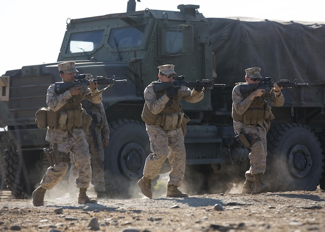 U.S. Marines with Company A, Law Enforcement Battalion, I Marine Expeditionary Force Headquarters Group, practice weapons training during I MEF Large Scale Exercise 2016 at Marine Corps Air Station Miramar, Calif., Aug. 17, 2016. LSE-16 simulates the planning, deployment and combat operations of a MEF-level force of more than 50,000 military members within a partner country while operating alongside coalition forces. The exercise includes cyber and electronic warfare, information support operations, and simulated and live-fire events. (U.S. Marine Corps photo by Sgt. Tia Dufour)
