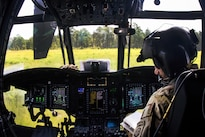 An Army pilot shuts down his CH-47 Chinook helicopter on a drop zone before transporting soldiers and artillery to support of a gun raid and live-fire exercise at Fort Bragg, N.C., Aug 12, 2016. Army photo by Capt. Adan Cazarez