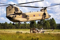 Paratroopers lift the reach pendant before slingloading a M777A2 howitzer to a CH-47 Chinook helicopter during a gun raid and live-fire exercise at Fort Bragg, N.C., Aug 12, 2016. Army photo by Capt. Adan Cazarez