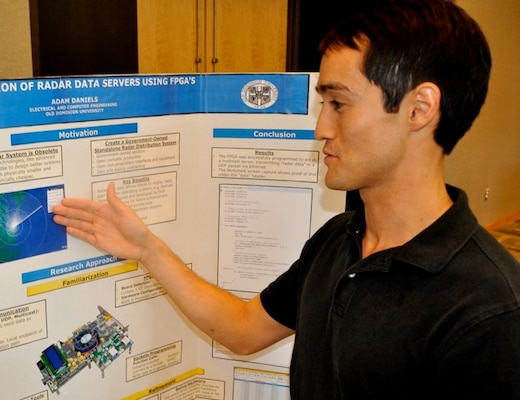 "DAHLGREN, Va. — Old Dominion University student Adam Daniels presents his research on an ""FPGA (field-programmable gate array) Programmer"" to military and government personnel during his 2016 summer internship. Daniels - among 22 students who completed their internships at Naval Surface Warfare Center Dahlgren Division (NSWCDD) - is working towards a bachelor's degree in electrical and computer engineering. ""Before this internship, I wasn't sure what I wanted to do after graduating,"" said Daniels. ""Now, I can't wait to graduate and eventually work here to continue my project. NREIP (Naval Research Enterprise Intern Program) has given me direction, purpose, and motivation to finish school and become an engineer."""