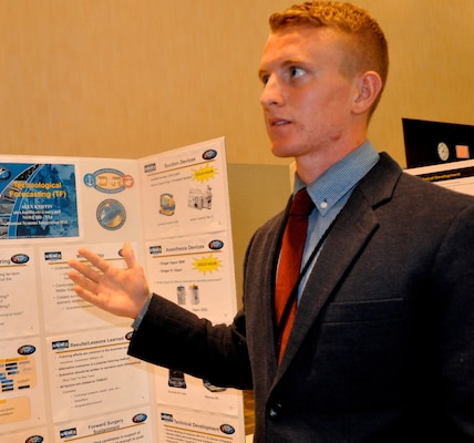 "DAHLGREN, Va. — Virginia Commonwealth University student Alex Kniffin presents his research on ""Wide-Aperture Forecasting"" to military and government personnel during her 2016 summer internship. Kniffin - among 22 students who completed their internships at Naval Surface Warfare Center Dahlgren Division (NSWCDD) - is working towards a bachelor's degree in computer science. Kniffen developed a framework for creating alternative scenarios in order to create a prediction on the advancements of technology and reduce technological surprise. ""This allowed him to work with technical experts to incorporate their knowledge into the technological forecasting process,"" said Dr. Elizabeth Haro, Human Systems Integration engineer. The Naval Research Enterprise Intern Program (NREIP) encourages students to pursue science and engineering careers, furthers education via mentoring and their participation in research, and makes them aware of Navy research and technology efforts, which can lead to civilian employment within the Navy."