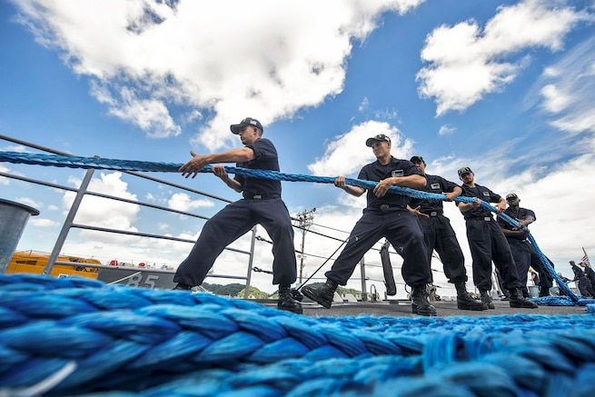 Sailors heave a line aboard the USS Chancellorsville to depart Fleet Activities Yokosuka, Japan, Aug. 21, 2016, as a precaution for tropical storm Mindulle. The Chancellorsville is supporting security and stability in the Indo-Asia-Pacific region. Navy photo by Petty Officer 2nd Class Andrew Schneider