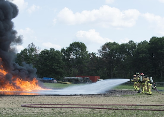 Air Force Reserve firefighters extinguish a fuel fire during exercise Patriot Warrior, Aug. 18, 2016, Sparta/Fort McCoy Airport, Wis. Patriot Warrior allows Air Reserve fire fighting units from throughout the U.S. to train together and learn from professionals throughout the career field in a deployment-style environment. (U.S. Air Force Photo/ Tech. Sgt. Nathan Rivard)