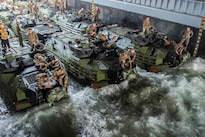 Marines secure amphibious assault vehicles in the well deck of the amphibious dock landing ship USS Germantown near Okinawa, Japan, Aug. 21, 2016. The Germantown is supporting security and stability in the Indo-Asia-Pacific region. Navy photo by Petty Officer 2nd Class Raymond D. Diaz III