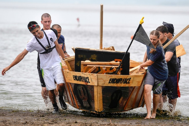 Sailors  haul a homemade boat onto the beach during an annual boat regatta in Misawa, Japan, Aug. 19, 2016. Eight teams from the Navy and Air Force competed this year. The sailors are assigned to Naval Air Facility Misawa. Navy Photo by Petty Officer 2nd Class Samuel Weldin