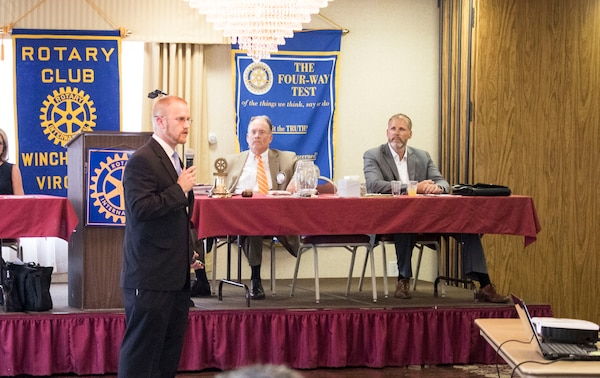 Joey Behr, a project manager with the U.S. Army Corps of Engineers, Middle East District addresses the Rotary Club of Winchester during their monthly luncheon Aug. 11 at the Travelodge in Winchester.
