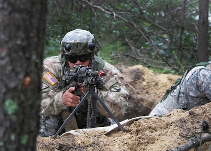 FORT MCCOY, Wis. – U.S. Army Reserve Soldier, Spc. Juan Adorno, from Morovis, Puerto Rico, a military policeman with the 301st MP Company, Puerto Rico, surveys the base perimeter from a foxhole during a combat support training exercise at Fort McCoy, Wis., Aug. 19, 2016. The 301st was tasked with provided base defense during the exercise, which included foxhole perimeter defense, theater defense facility security, quick reaction force teams and entry control point teams. (U.S. Army Reserve Photo by Sgt. Quentin Johnson, 211th Mobile Public Affairs Detachment/Released)