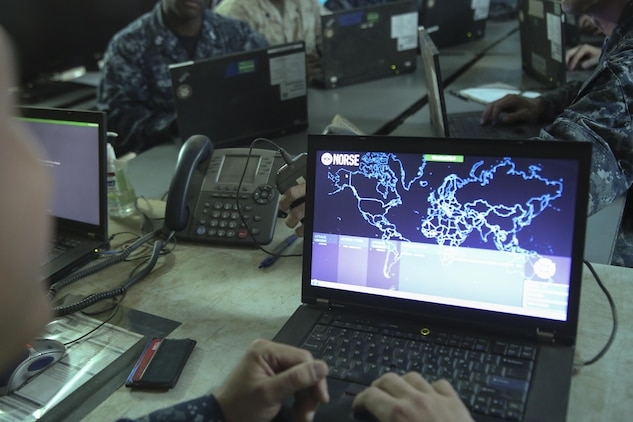 A sailor with 553 Cyber Protection Team opens a network monitoring program during I Marine Expeditionary Force Large Scale Exercise 2016 at Marine Corps Air Station Miramar, Calif., Aug 22, 2016. The overall purpose of the exercise was to practice the deployment of a fighting force of more than 50,000 military personnel to a partner nation and incorporate both live-fire and simulated combat scenarios against a near-peer enemy force. 553-CPT is a team of cyber defense specialists with Fleet Cyber Command. The team advised I MEF while setting up the command element's networks.