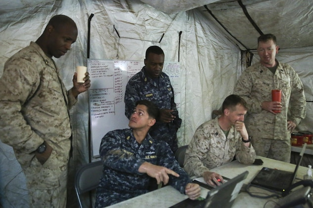 Marines with I Marine Expeditionary Force and sailors with 553 Cyber Protection Team, monitor network activity during I MEF Large Scale Exercise 2016 (LSE-16) at Marine Corps Air Station Miramar, Calif., Aug 22, 2016. The overall purpose of the exercise was to practice the deployment of a fighting force of more than 50,000 military personnel to a partner nation and incorporate both live-fire and simulated combat scenarios against a near-peer enemy force. 553-CPT is a team of cyber defense specialists with Fleet Cyber Command. The team advised I MEF while setting up the command element's networks.