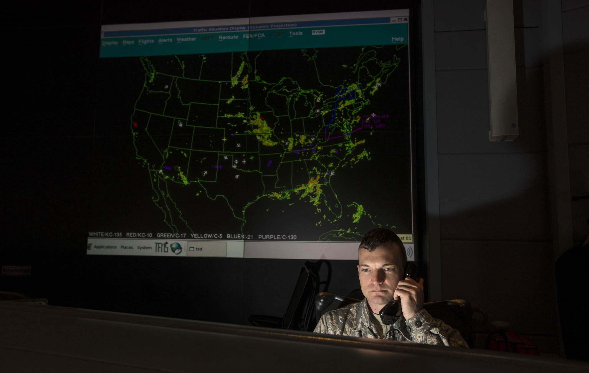 Tech. Sgt. James Sayres, a channel mission manager, checks the air schedule for the 618th Tanker Airlift Control Center at Scott Air Force Base, Ill., Aug. 1, 2016. Ongoing work by the Air Force and Army has filled training schedules by streamlining the Joint Airborne/Air Transportability Training program, an online system used by military units to request air support. (U.S. Air Force photo/Master Sgt. Brian Ferguson)