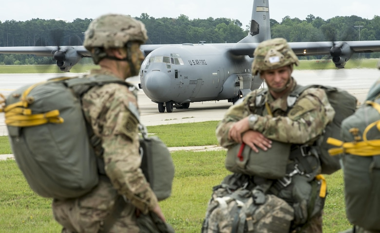 Soldiers from the 82nd Airborne Division wait to board a C-130 Hercules at Pope Army Airfield, Fort Bragg, N.C., Aug. 4, 2016. Ongoing work by the Air Force and Army has filled training schedules by streamlining the Joint Airborne/Air Transportability Training program, an online system used by military units to request air support. (U.S. Air Force photo/Master Sgt. Brian Ferguson)