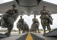 Soldiers from the 82nd Airborne Division board a C-130 Hercules at Pope Army Airfield, Fort Bragg, N.C., Aug. 4, 2016. Ongoing work by the Air Force and Army have filled training schedules by streamlining the Joint Airborne/Air Transportability Training program, an online system used by military units to request air support.(U.S. Air Force photo/Master Sgt. Brian Ferguson)