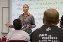 As part of a practical application, Becca Saal practices different briefing techniques with her fellow coaches during the 2016 Coaches Workshop at Marine Corps University aboard Marine Corps Base Quantico, Va., Aug. 4. The workshop creates a mutually beneficial relationship between coaches and the Marine Corps, where coaches can share knowledge about the Corps based on firsthand experience. Saal is the head volleyball coach for Carroll University in Waukesha, Wis.