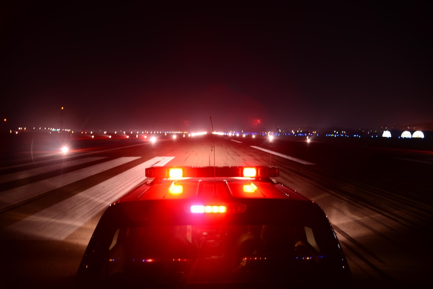 Airmen from the 51st Operations Support Squadron airfield management operations flight conduct a check of the runway lights during Exercise Beverly Herd 16-2, Osan Air Base, Republic of Korea, Aug. 24, 2016. BH 16-2 is a week-long exercise that tests Osan team members' abilities to accomplish their wartime missions. (U.S. Air Force Photo by Staff Sgt. Rachelle Coleman)