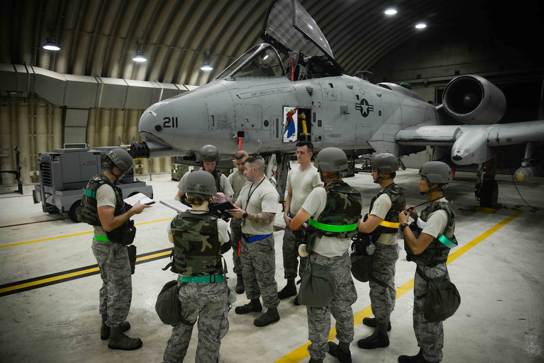 Airmen from the 51st Maintenance Group gather to discuss preflight inspections during Exercise Beverly Herd 16-2 at Osan Air Base, Republic of Korea. The 51st MXG maintain and inspect the A-10 Thunderbolt II aircraft, which provides close air support, air strike control and combat search and rescue capabilities to the 51st Fighter Wing in support of the defense of the ROK. (U.S. Air Force photo by Senior Airman Dillian Bamman)