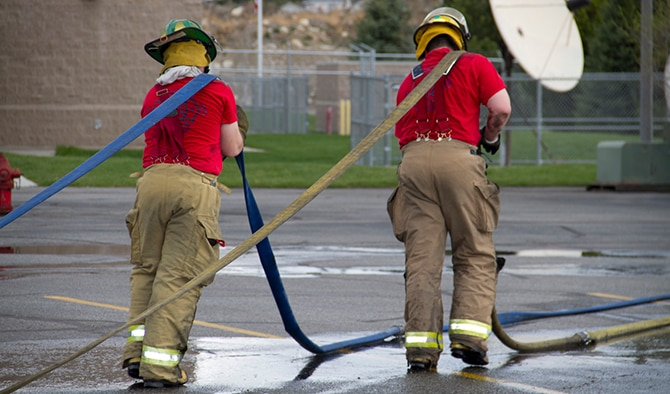 Spokane County Fire District 10 firefighters train during a West Plains Academy course December 4, 2014. After completion of the 12-week academy, firefighters continue their training with extensive emergency medical technician training and perfecting basic firefighting skills. (Courtesy Photo)