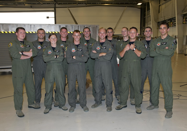Tyndall's F-22 Raptor Basic Course graduating class 16-ABR gathers in Hangar 5 after their graduation Aug. 19, 2016. Twelve students completed the seven-month-long course, making it the largest F-22 B-Course class in history. (U.S. Air Force photo by Staff Sgt. Alex Fox Echols III)