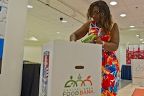 "Defense Department employee Naniece Shields donates food for the Feds Feed Families food drive at the Pentagon, Aug. 23, 2016. ""I know it's the right thing to do. A lot of people do go hungry,"" Shields said. ""There are a lot of kids out here who do go hungry at night, so I just felt it was my duty."" DoD photo by Lisa Ferdinando"