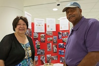 Diane Carter and her husband, William Carter, explain how the Bread of Life Food Pantry benefits from the Feds Feeding Families campaign during a charity fair at the Pentagon, Aug. 23, 2016. DoD photo by Lisa Ferdinando