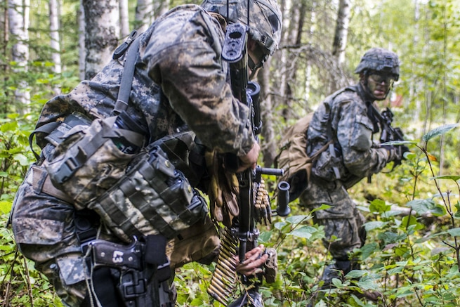 Soldiers react to contact during exercise Spartan Agoge at Joint Base Elmendorf-Richardson, Alaska, Aug. 18, 2016. The battalion trained in close combat, reconnaissance, chemical warfare and infiltration skills. Army photo by Staff Sgt. Daniel Love