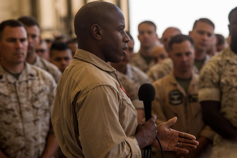 """Sgt. Maj. James Porterfield, 3rd Marine Aircraft Wing sergeant major, speaks to Marines with Marine Aircraft Group 11 during a one-day """"reset"""" aboard Marine Corps Air Station Miramar, Calif., Aug. 9. During the reset, units across 3rd MAW suspended nearly all air field and shop operations to develop plans and improve their section's operational readiness. (U.S. Marine Corps photo by Sgt. Lillian Stephens/Released)"""