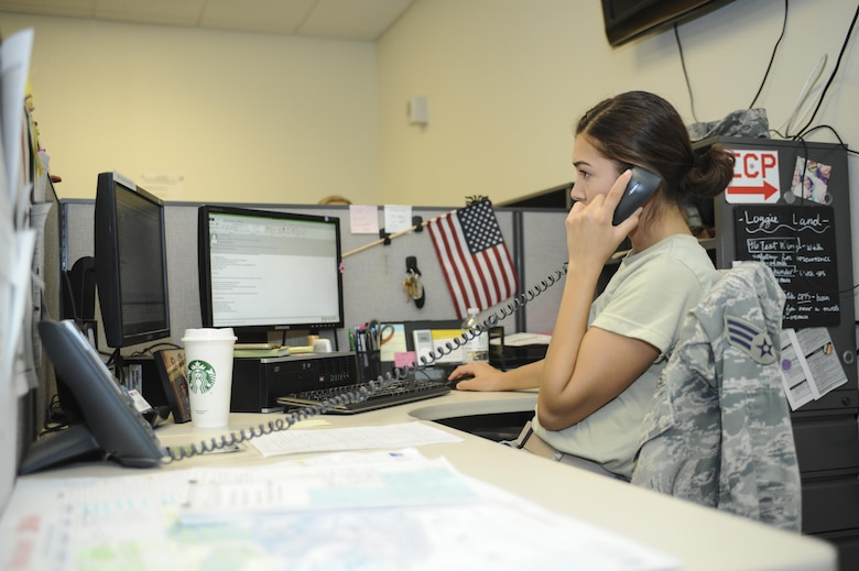 U.S. Air Force Senior Airman Corina Delgado, 355th Logistics Readiness Squadron logistics planner, responds to an incoming call at Davis-Monthan Air Force Base, Ariz., Aug. 16, 2016. In the year of 2016, the 355th LRS logistics planners have deployed approximately 1,000 personnel and have deployed roughly forty percent of that within this past July, resulting in 422 personnel and 3.7 tons of cargo.  (U.S. Air Force photo Airman 1st Class Mya M. Crosby)