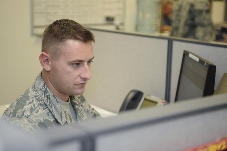 U.S. Staff Sgt. Brian Bober, 355th Logistics Readiness Squadron NCO in charge of deployments, checks his email at Davis-Monthan Air Force Base, Ariz., Aug. 16, 2016. Logistics planners are responsible for supervising deployments, redeployments and maintaining a close relationship between operations, logistics and support organizations to enhance support of the combat mission and develop crisis action procedures. (U.S. Air Force photo by Airman 1st Class Mya M. Crosby)