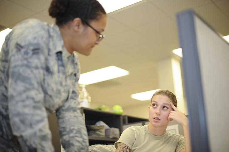 U.S. Air Force Airman 1st Class Joice Dominguez and Dejah Grant, 355th Logistics Readiness Squadron logistics planners, communicate on deployment details at Davis-Monthan Air Force Base, Ariz., Aug. 18, 2016. The logistics planners deploy Airmen in support of five combatant commands. (U.S. Air Force photo by Airman 1st Class Mya M. Crosby)