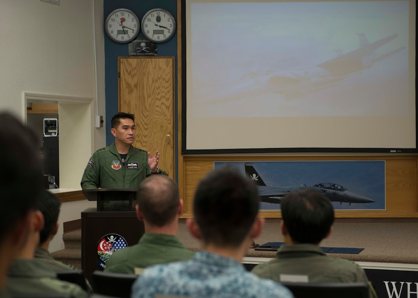 Republic of Singapore Lt. Col. Tham Yeow Min, 428th Fighter Squadron senior ranking officer, speaks during the F-15SG Fighter Weapons Instructor Course graduation Aug. 19, 2016, at Mountain Home Air Force Base, Idaho. The course was the first of its kind for the RSAF, and was modeled after the U.S. Air Force's weapons school. (U.S. Air Force photo by Airman 1st Class Chester Mientkiewicz/Released)