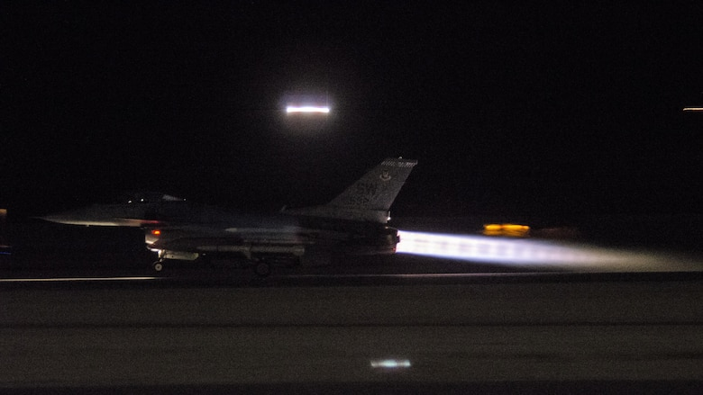 An F-16CM Fighting Falcon assigned to the 55th Fighter Squadron, Shaw Air Force Base, S.C., takes take off while conducting a night sortie during exercise Red Flag 16-4 at Nellis AFB, Nev., Aug. 17, 2016. The 55th FS flew two missions daily, a night and day sortie, in support of Red Flag 16-4 to provide suppression of enemy air defenses. (U. S. Air Force photo by Tech. Sgt. Frank Miller)