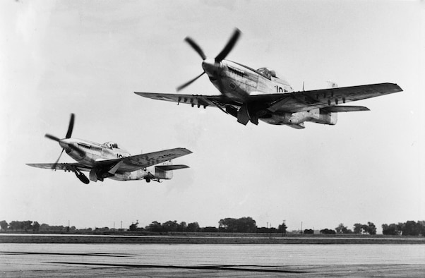 Two P-51 fighter aircraft assigned to the 174th Fighter Squadron, Iowa National Guard take off at the airport in Sioux City, Iowa in the spring of 1948. The Mustangs were the first aircraft assigned to the newly organized air arm of the Iowa National Guard when it was first organized in 1946.