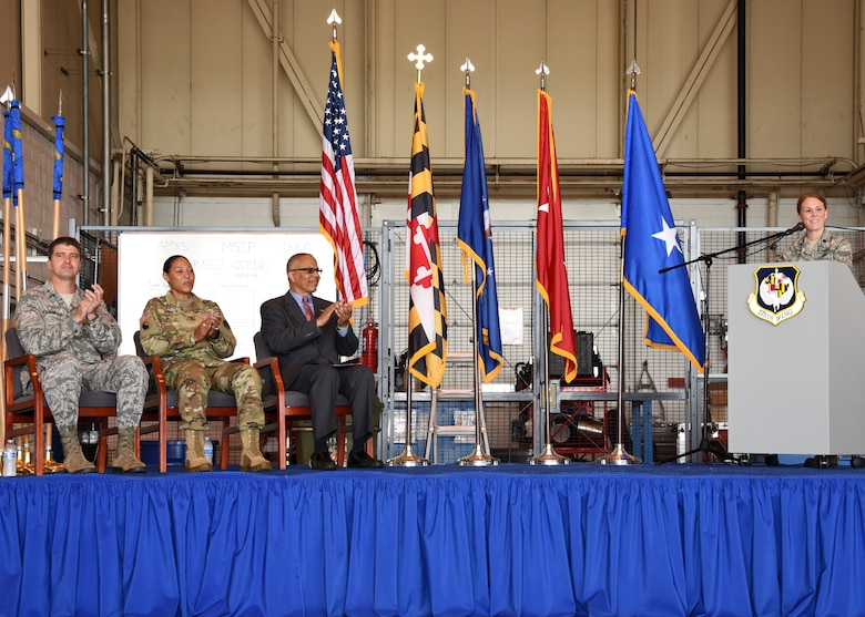 U.S. Air Force Brig. Gen. Randolph Staudenraus, 175th Wing commander, U.S Army Maj. Gen. Linda Singh, the adjutant general of Maryland and the State of Maryland Lt. Governor Boyd K. Rutherford applaud while U.S. Air Force Lt. Col. Jori Robinson initiates the commencement of the 175th Cyberspace Operations Group activation ceremony, August 21, 2016 at Warfield Air National Guard Base, Middle River, Md. The ceremony recognized the activation of the 175th COG, and its three squadrons, 275th Cyberspace Operations Squadron, 275th Operations Support Squadron, and the 276th Cyberspace Operations Squadron along with the re-designation of the 175th Cyberspace Operations Squadron and the 135th Intelligence Squadron. (U.S Air National Guard Photo by Airman 1st Class Enjoli Saunders/RELEASED)