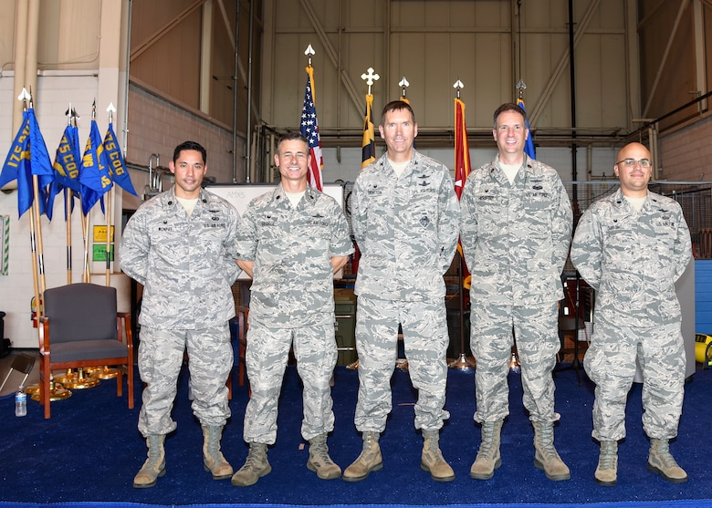 Lt. Col. Andrew Wonpat, Col. Kevin B. George, Col. Shawn Bratton, Maj. Thomas Herster, and Lt. Col. Joed Carbonell (left to right) pose for a photo at the completion of the 175th Cyberspace Operations Group activation ceremony, August 21, 2016 at Warfield Air National Guard Base, Middle River, Md. The ceremony recognized the activation of the 175th COG, and three squadrons, 275th Cyberspace Operations Squadron, 275th Operations Support Squadron, and the 276th Cyberspace Operations Squadron along with the re-designation of the 175th Cyberspace Operations Squadron and the 135th Intelligence Squadron. (U.S Air National Guard Photo by Airman 1st Class Enjoli Saunders/RELEASED)