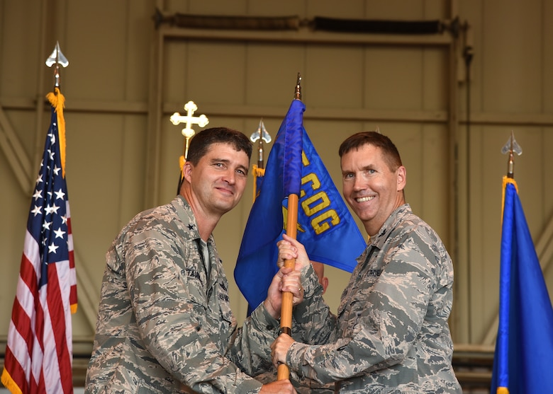 U.S. Air Force Col. Shawn Bratton assumes command of the 175th Wing Cyberspace Operations Group, Maryland Air National Guard, by receiving the guide-on from U.S. Air Force Brig. Gen. Randolph Staudenraus, 175th Wing commander, during an activation ceremony, August 21, 2016 at Warfield Air National Guard Base, Middle River, Md. (U.S. Air National Guard Photo By A1C Enjoli Saunders/RELEASED)